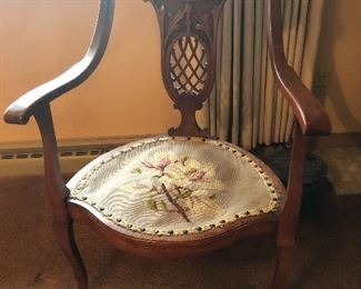 Carved chair with needlepoint seat.
