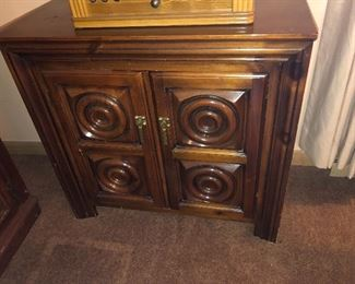 There are 2 of these solid wood cabinets.
