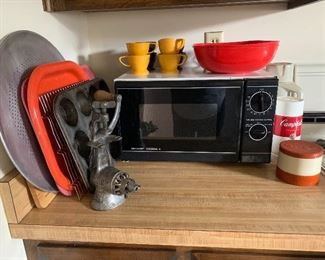 Meat grinder and working microwave
