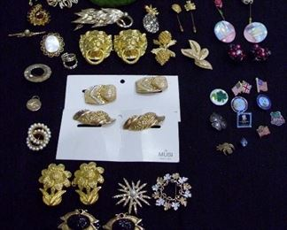 assorted pins, musi tusi's,  belt buckels and more