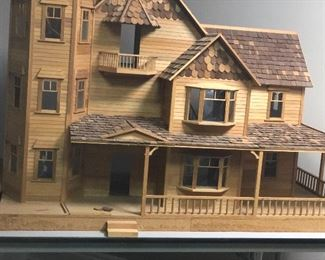 Unfinished doll house with carpet lighting furniture wall paper everything to finish it .
