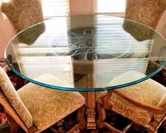 Lg Glass, wood, and iron dining table with 4 chairs