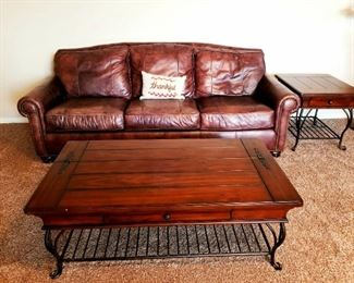 Leather sofa with wooden end table and coffee table