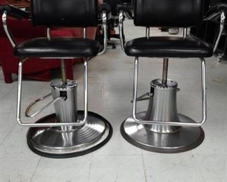 Two Vinyl Covered Barber Salon Chairs