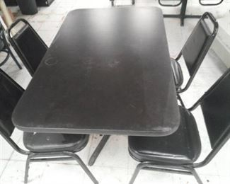 Black Formica Top Table and Four Metal Vinyl Padded Chairs