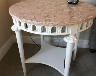 Round marble-top vintage lamp table.  Useful in most rooms. 26 wide by 27 tall. Price:  $135