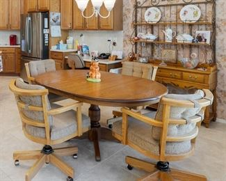 Kitchen table and chairs along with an extra nice baker's rack that has drawers.