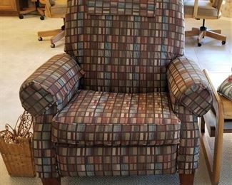 Modern patterned club chair that looks like new too.