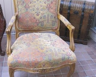A pair French Style Armchairs with needle point upholstery .