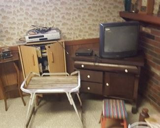 TVs, electronics, small tables. Lots of records, tapes, CDs, etc.