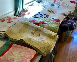 Lots of hand made quilts