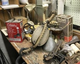 Coleman tin, old pulley, tools