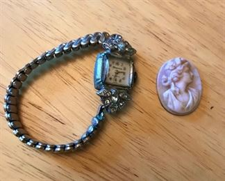 Old watch and pink cameo