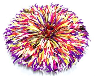 Feathered Ceremonial Bamileke dancing hat  from Cameroon, also used as a decorative wall  hanging accessory. Feathers in rich shades  of  magenta, purple, orange, and white tones.  Woven grass base for structure, hats can be compressed and wrapped for storage. When  opened, hat measures approx 32 inches in  diameter by 6 inches in depth. When  compressed, hat measures approx 18 inches  diameter by 13.5 inches in depth. Property of a New York Private Collection. 'The Juju Hat or as they are called in  Cameroon the Bamileke or Tyn hats from the  Bamileke tribes have come a long way from  being traditional ceremonial headdress to adourning beautiful interior designer homes  as contemporary wall hangings. For hundreds of years the Bamileke tribes  have been creating these hats for their  tribal chiefs, royal families and dignitaries.
