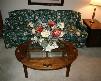 Oval Drop Sides with Beveled Glass Coffee Table. Green Floral Motif Sofa