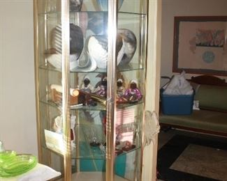 Very nice vintage brass and glass display case that lights up.