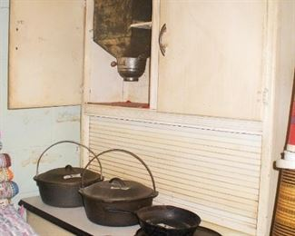 ANTIQUE KITCHEN CUPBOARD WITH METAL FLOUR SIFTER, METAL BREAD DRAWER, ROLL TOP, PORCELAIN TOP. NOTE CAST IRON.  GRIDDLE IS WAGNER