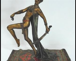 "Art Nouveau Metal Sculpture of Woman with Sword on Persian Rug. Approximately 9"" tall."