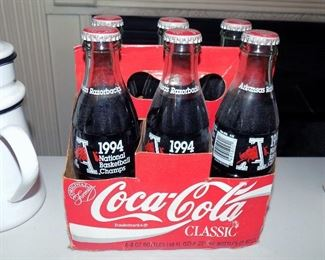 1994 commemorative National Basketball Champs Razorbacks, six 8oz cokes