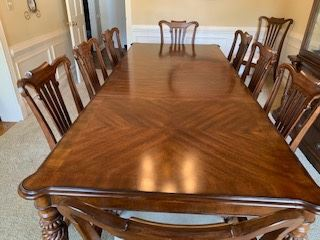 Broyhill Dining Table with 8 Chairs with 2 Captain Chairs and China Cabinet