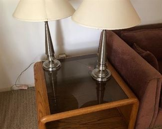 End table with glass top plenty of storage with two brushed chrome lamps