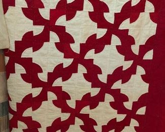 1930's handsewn and hand quilted Drunkard's Path quilt
