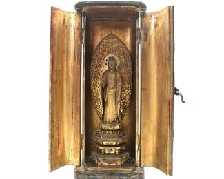 Japanese lacquer shrine with standing Buddha.