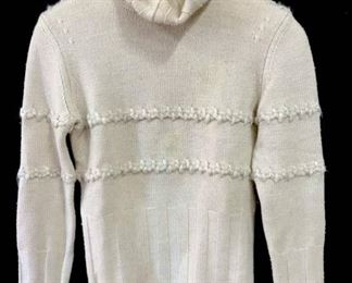 Hand-Embroidered knit sweater. Label reads  for LES COPAINS, Size 42. Sweater is oatmeal  beige in tone. Good condition, might need  spot cleaning. Designer fashion garment,  luxury designer clothing, sweater turtleneck,  cold weather garment, Hand-Embroidered knit  sweater, luxury Designer fashion, wearable.  Property of a Greenwich, CT Estate.
