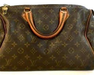 https://www.liveauctioneers.com/item/76226506_vintage-louis-vuitton-handbag