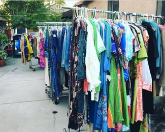 racks of higher end pieces individually priced -boho, 50s day dresses, moo moos, kaftans, 60s, 70s, 80s dresses, Polyester dresses