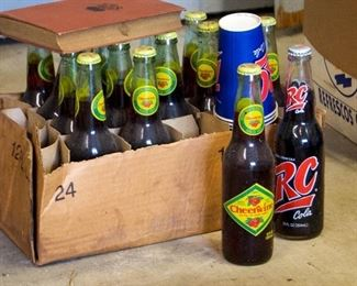 Lots of vintage and new RC and other soda bottles and vintage RC wooden crates