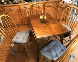 Drop leaf dinette with four chairs.