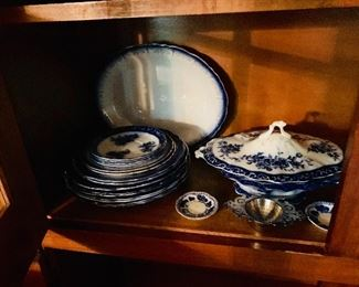 Flow blue plates tureens and accoutrements.