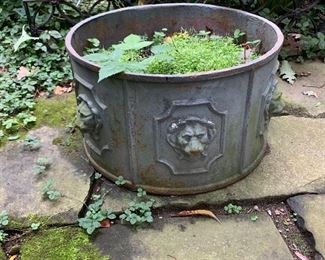Vintage metal planter with lions.