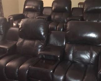 Genuine Leather Lazy Boy Theater seating with electric recline and outlets/cupholders/drawer in each console
