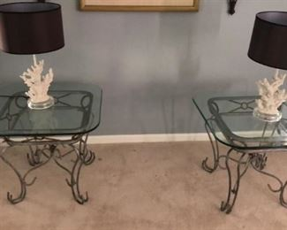 Metal glass top end tables. Lamps. Wall decor including large sconces