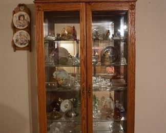 display cabinet with butter dishes, collectibles