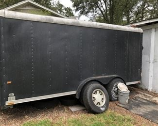 14 ft enclosed trailer double axle That is an extra tire. The inside is very nice!!