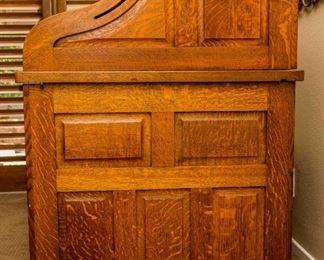Nice grain in quarter sawn panels of antique roll top desk.
