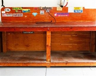 """Very sturdy, hand built work bench. 6 legs are 4"""" x 4"""" and horizontal pieces are 2"""" x 4"""". Bench work surfaces are 1"""" finished plywood. Fastened with lag screws and carriage bolts. This is 8' long X 30"""" deep and 48"""" tall.  Work surface at 37"""" high. This is a seriously sturdy bench!"""