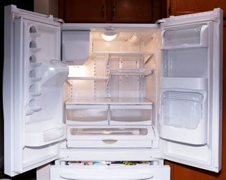 Maytag MFI2568AEW 24.9 cu. ft. refrigerator/freezer. French door fridge with filtered cold water dispenser, ice maker dispenser in door, bottom pull-out freezer section.