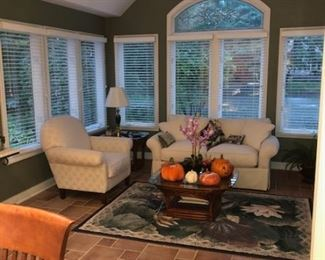 Comfortable seating, fall decor, and lamps, side tables, and rug