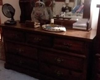 Wood dresser with mirror; vintage purses; fan