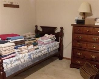 Cannonball headboard twin bed frame; highboy dresser; bedding and assorted linens