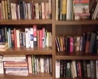 Assortment of books and Sauder style bookshelves