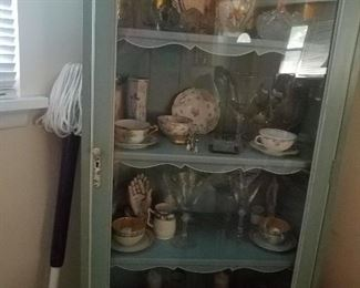 beautiful corner cabinet and contents