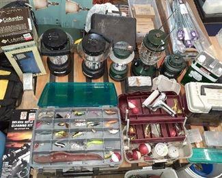 rifle cleaning kit, fishing lures, tackle boxes, poles, camping lanterns