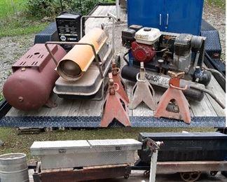 Coleman Black Max air compressor, lumber carts, Master salamander, battery charger, truck bed tool boxes, engine stand, beer keg