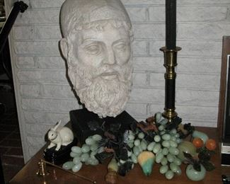 Group of grapes and bearded man with candlestick in back ground