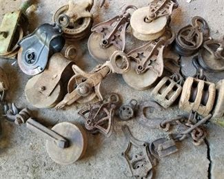 Many vintage pulleys